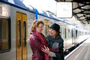 16639913-happy-smile-for-two-friends-as-they-greet-each-other-at-an-outdoor-train-station-platform