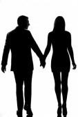 woman-walking-hand-in-hand-in-studio-silhouette-isolat