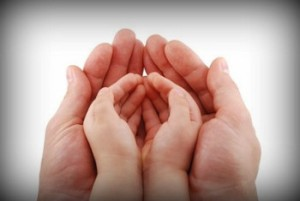 Adult-hands-with-child-hands4-e1355768613941-350x235