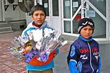 children selling flowers