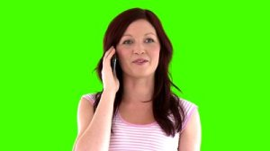 stock-footage-beautiful-woman-answering-to-the-phone-against-a-green-screen